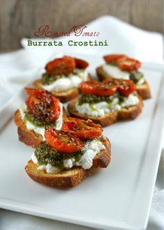 Roasted Tomato Pesto Burrata Crostini--- I think I could substitute mozerella for burrata cheese...