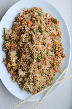 Chicken Fried Rice (subbed with Costco $5 chicken, TJ's frozen veggie mix I had leftover, served with sriracha) - Thumbs up!