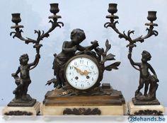 schouwgarnituur met engelen brons