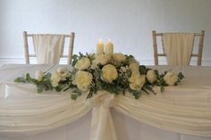 Inside the Windsor Suite at Bartle Hall we'd placed the traditional Registrars table design provided by Bartle Hall of White Peonies and Gypsophilia with Eucalyptus and two chapel candles in the centre