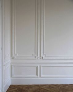 Classic architectural wall embellishments featuring decorative wall panels, chair rail and baseboard molding; paneled wall ideas; wall paneling