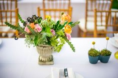 gorgeous floral arrangements from BowsandArrowsDeluxe.com