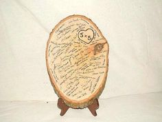 wood slice guest book by margarett