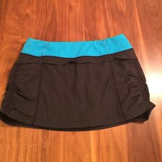 """Lululemon Run Jog Skirt Black with blue waistband. Shorts lining with rubber gaskets at leg opening to keep in place. Gathered sides. 11.5"""" skirt length. lululemon athletica Other"""