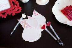 Perfect raindrops for writing advice at a baby or bridal shower. Love the pens with pink and red hearts.
