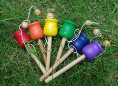 Classic Toy Wooden Ball and Cup Toss Game, Old Fashioned Waldorf Toy, CHOOSE ONE COLOR. $8.95, via Etsy.
