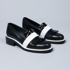 Gardenia Women's  Black And White Fringe Round Toe Shoes: Black and white fringe round toe shoe. The humble fringed shoe has been given a contemporary makeover with this chic design from Gardenia. The ideal way to cap off any monochrome look, these shoes feature a textile band that adds a lovely contrast.