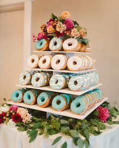 How sweet is this donut display?? Don't worry, they had a gorgeous cake for their guests as well! You can never have too many sweets at a wedding, right?! : @wyattestrazzo : @nannetteyorkfloral