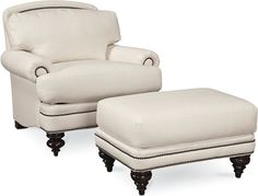 Westport Chair  The Westport Chair offers classical allure and exquisite craftsmanship found in its New England namesake towns. Its rolled panel arms, nailhead trim, turned legs, and loose pillow back offer soft, curved lines that bring grace to your living room.