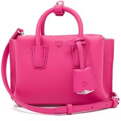 MCM Micro Milla Tote ($525) ❤ liked on Polyvore featuring bags, handbags, tote bags, beetroot pink, tote handbags, genuine leather tote, leather crossbody purse, pink tote and leather tote handbags