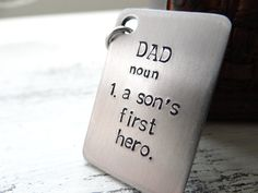 Hey, I found this really awesome Etsy listing at http://www.etsy.com/listing/159887615/dad-a-sons-first-hero-keychain-for-dad