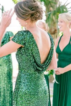 Emerald green, sequined drape-back bridesmaid dresses | Gold, Black, White + Green Lowndes Grove Plantation Wedding by Charleston wedding photographer Dana Cubbage Weddings