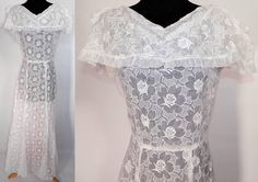 Vintage White Organdy Embroidered Roses Shawl Collar Dress. This vintage white organdy embroidered roses shawl collar dress dates from the 1930s. It is made of a sheer white organdy fabric, with a white stitched, raised padded satin stitch floral roses pattern design.
