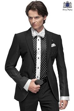 Italian bespoke fashion suit, black jacket in wool-polyester fabric, with fashion peak lapel and 1 button; coordinated with black trousers, style 60766 Ottavio Nuccio Gala, 2015 Emotion collection.