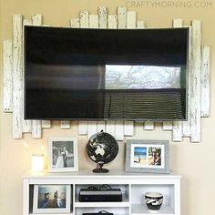 This wood pallet accent piece is just GORGEOUS! You hang it behind a mounted TV…