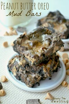 Chocolate Mud Bars with a Peanut Butter Oreo crust - these bars are rich, decadent, and dangerously delicious!...