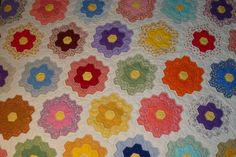 I get to use my Great-Grandmother's hand-pieced hexagonal quilt on my bed in the new room. :-) It has a lot of pink and green so I'll have to work those in the room somehow. This is not an image of my quilt, just similar.