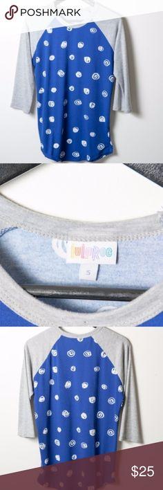 LuLaRoe Randy Blue White Circle Swirl Baseball Tee Great preloved Lularoe Randy baseball t-shirt. Some very minor pilling. Worn two times. Heather grey sleeves, blu with white circle swirl pattern. 3/4 sleeve LuLaRoe Tops Tees - Long Sleeve
