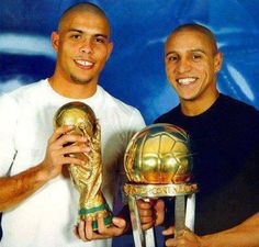 2002: Ronaldo (World Cup Trophy with Brazil & Ballon d'Or with Real Madrid) & Roberto Carlos (Seleção do Brasil & Ballon d'Or with Real Madrid)