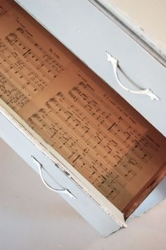This is a brilliant idea.  No contact paper needed, just some old sheet music.  So smart.