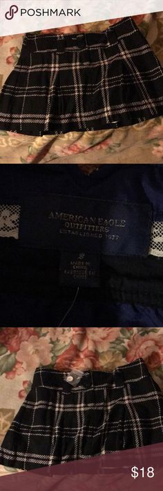 American eagle skirt size 2 American eagle skirt SIZE 2 NEVER WORN BRAND NEW  NO TAG BUT EXTRA BUTTON (look at picture) Super cute for a night out  Black and cream color Was too small, that's why I'm selling it  😊 American Eagle Outfitters Skirts Mini