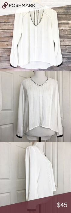 """Daniel Rainn Blouse Beautiful white blouse by Daniel Rainn.  Features black trim with beading at the v cut neckline and hem if sleeves.  Has back zipper with a lacy insert.  Material is 100% polyester.  Measurements laid flat: bust 20"""" and length from top of shoulder to hem in front is 22 inches and the back 29 inches.  🚫 no trades🚫 no lowball offers🚫 Daniel Rainn Tops Blouses"""