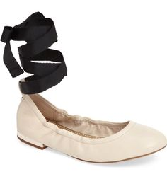 Ballet-inspired ribbon laces top a ballet flat detailed with a gleaming heel and classic colors.