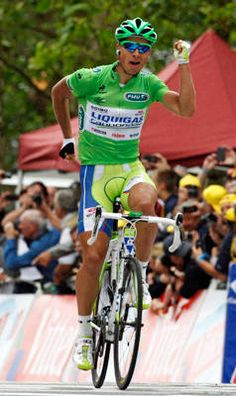 Liquigas-Cannondale rider Peter Sagan of Slovakia holds up his arms as he wins the third stage of the 99th Tour de France cycling race between Orchies and Boulogne sur mer, July 3, 2012.