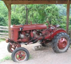 1947 Farmall-A tractor on exhibit at the Educational Farm. Western North Carolina Nature Center, 2006 : Cultural Heritage Institutions of North Carolina, NC ECHO Project. NC Digital Collections. ^mcu