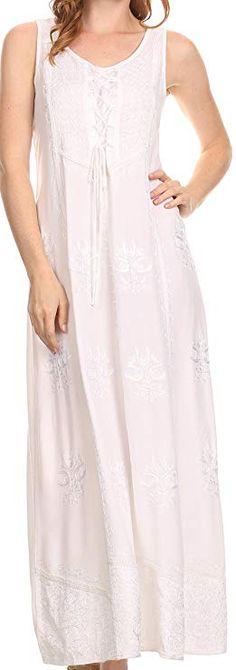 Dress features a really gorgeous embroidery design throughout the  front of the dress. Material is lightweight and made to give the most  flattering drape for any figure. Dress has a corset style front on the  upper bodice that can be laced and tied.