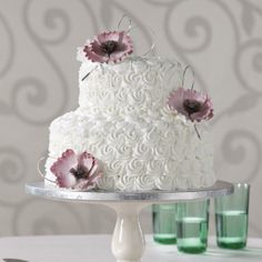 Publix cake with butter cream icing... maybe add a tier... take away the flowers and add coral icing made flowers to the sides of top layer. Boom! lol