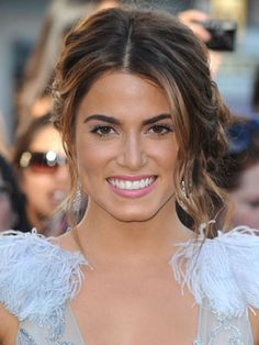 Nikki Reed's loose side-bun is effortlessly pretty!