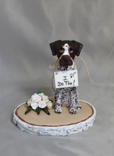 Dog Cat Pet custom polymer clay wedding cake topper. A German Wirehaired Pointer with floral bouquet including 3 peacock feather on a birch tree wood look base.