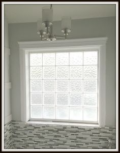 Who doesn't have one of these glass block windows in their bathroom....come on over to see how to dress it up and make it a gorgeous!!  This is a SUPER easy DIY project!!