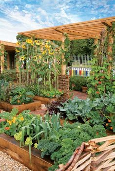Beauty and productivity harmonize in an intensively planted garden when you add flowers and natural, structural elements.    Photo by judywhite/GardenPhotos.com By Linda A. Gilkeson Whe...
