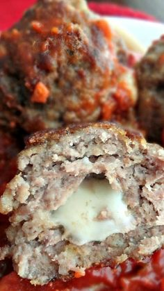 Mozzarella Stuffed Meatballs ~ These meatballs are moist, flavorful, and bursting FULL of cheesiness!