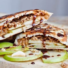 #Peanut butter, #apple and granola wraps make for a perfect quick #breakfast or light #glutenfree #snack. You've got the crunch from the granola, the fruity apple crispiness and the creamy peanut butter to blend it all together. Lightly grill them for that extra burst of flavors.