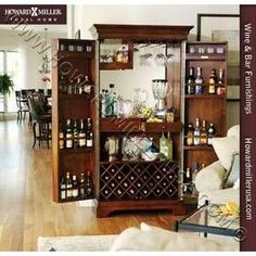 Howard Miller 695064Sonoma Hide-A-BarWine Spirits Storage cabinet SONOMA features a raised door panel and room to store 22 wine bottles with a generous amount of room for liquor storage. Finished in Americana Cherry on select hardwoods and veneers. A wooden stemware rack keeps wine glasses at convenient reach. An upper fixed shelf may hold glasses and tumblers. A 3x power strip outlet is located on the center shelf for operating small appliances. Two drawers provide ample utensil storage.