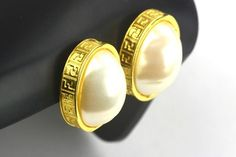 Fendi Chunky FF Monogram Pearl Clip-On Earrings. Get the lowest price on Fendi Chunky FF Monogram Pearl Clip-On Earrings and other fabulous designer clothing and accessories! Shop Tradesy now