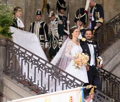 Man and wife: The royals walk hand-in-hand down the stairs - followed by a military proces...