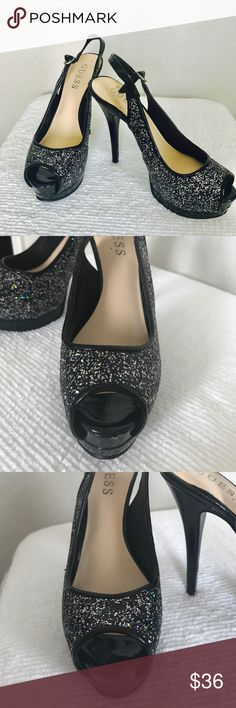 """GUESS brand 4.5"""" Platform Heels black sparkly GUESS brand 4.5"""" heels with a 2"""" platform. Size 5. Fairly comfortable for such tall shoes. Bought them brand new and worn only once to prom. Please note the picture of the nick on the front of one of the shoes otherwise good shape. Will accept reasonable offers. Guess Shoes Heels"""
