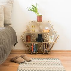 Ruche shelving unit is a simple, strong and smart storage and display system. This listing is for Medium shelves made of powder coated metal. The