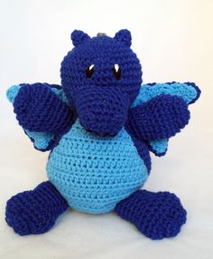 Fearsome blue dragon. Crocheted stuffed animal. Acrylic yarn and stuffing... can be machine washed. Perfect for young and old.