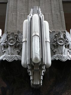 Art Deco light fixture on the AIG Building, New York.  The building was originally built for the Cities Service Company in 1930-2 and was designed by Clinton & Russell and Holton & George.  [1st of two pins]