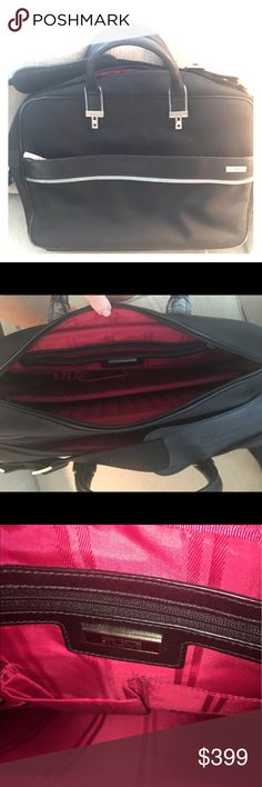 Tumi Women's Computer Bag Like new!! Barely ever used-perfect condition. Beautiful pink interior. Pocket for laptop and documents, pens, etc. Pocket with built in folders. Additional large pocket with smaller pocket inside. Perfect for being organized. Also has a bottom zipper to put on carry on suit case if desired. Shoulder strap (detachable) and smaller carrying handle. Bags Laptop Bags
