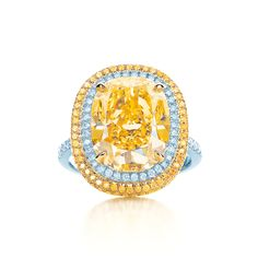 Tiffany & Co. Fancy Vivid yellow diamond ring in platinum with white diamonds. #TiffanyPinterest