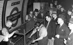 In pictures: Underground London during the Second World War - Telegraph Men look on as the last of the wartime bunks is dismantled on the platform of South Wimbledon station Picture: GETTY IMAGES