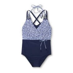 Make a statement on your next trip to the pool or beach in the 2-in-1 Floral One-Piece Swimsuit from Costa Del Sol. This stunning swimsuit gets a retro feel with the navy high-waisted bottom half, beautifully contrasted with the floral halter top. You'll get a secure, supportive and comfortable fit with the adjustable cross straps and hook closure along with the halter neck that ties at the back of the neck.
