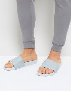 c2b297c988843 Shop adidas Originals Adilette Slider Flip Flops In Gray at ASOS.