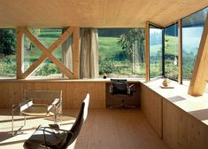 Swiss house by Pascal Flammer with wooden braces and a circular window
